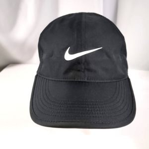 Nike Black with a white swoosh, hook/loop strap